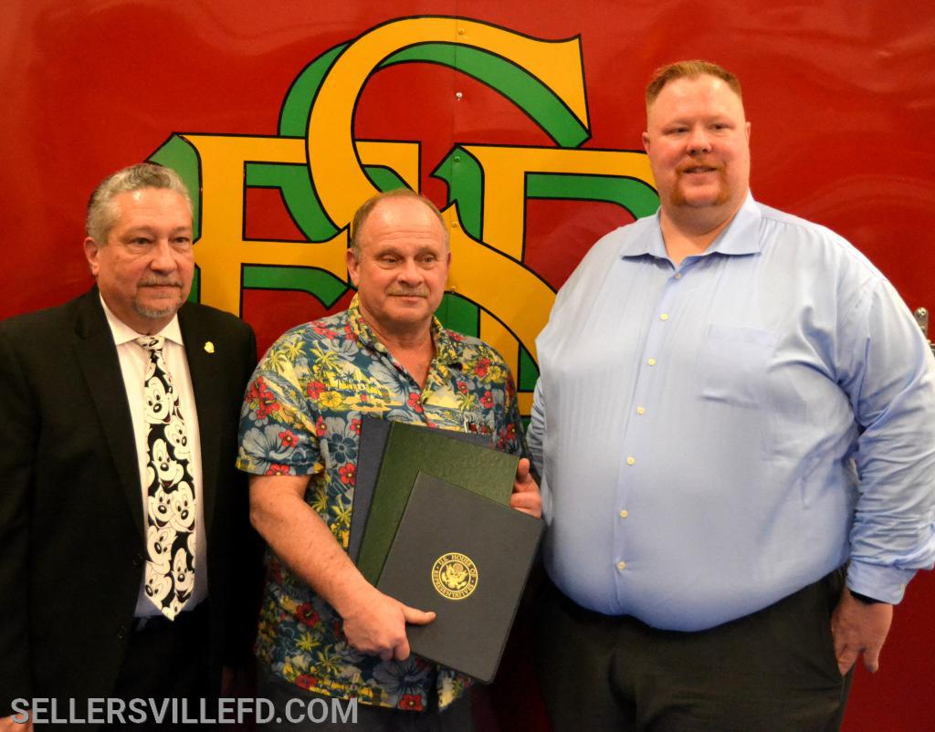 SFD President Greg Castelli [L], Harry McElhare, 45 Years of Service [C], SFD Chief Kurt Wagner [R]